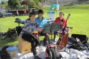 bella-and-her-musical-troupe-perform-at-a-community-planting-day-at-henderson-squash-club-in-2012
