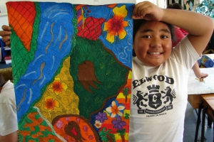 sharlene-from-flanshaw-road-primary-school-proudly-holds-up-her-project-twin-steams-inspired-art-work