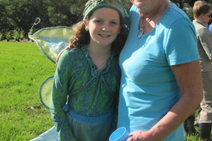 pat-watson-ceo-of-community-waitakere-with-her-granddaughter-on-stream-fairy-duty